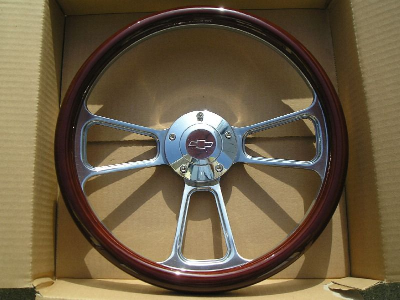This sale is for the steering wheel with WOOD wrap and a CHEVY LOGO